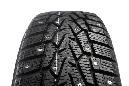 winter tire with snow spikes and protector photo