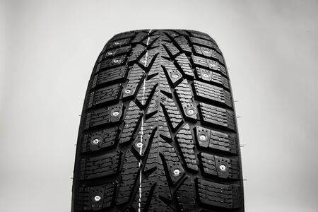 winter tire part on grey background photo