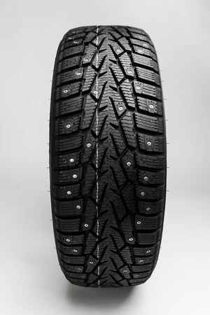 winter tire on grey background photo