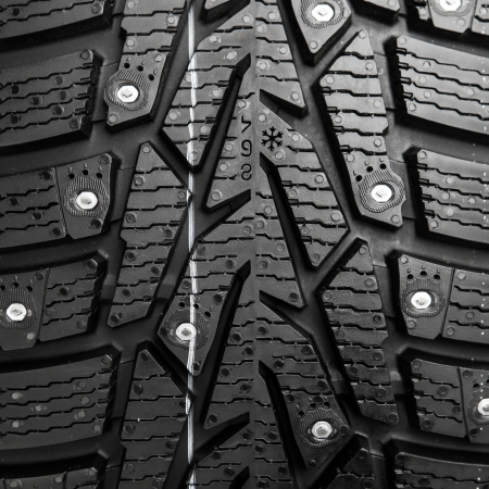 protector and snow spikes of winter tire photo