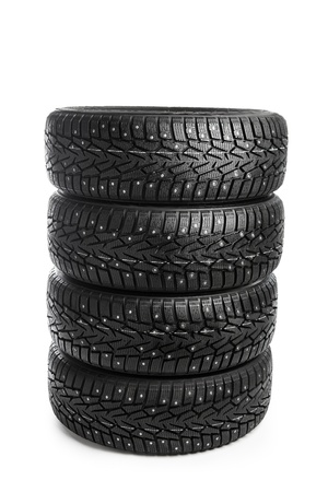 vulcanization: winter tires stack isolated on white Stock Photo