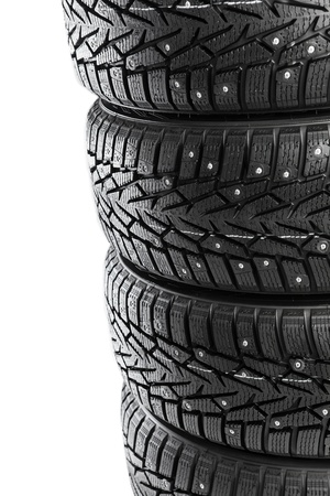 winter tires stack isolated on white photo