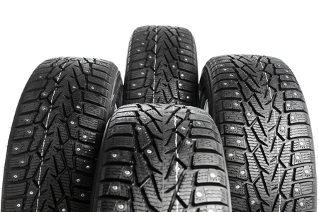 winter tyre: winter tires set isolated on white Stock Photo