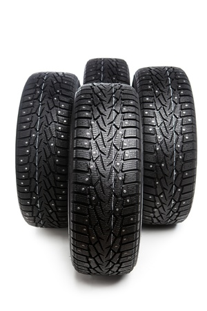 vulcanization: winter tires set isolated on white Stock Photo