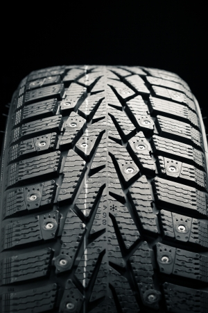protector and snow spikes of winter tire Stock Photo - 17012879