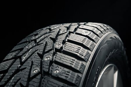 part of winter tire on black Stock Photo - 17012881