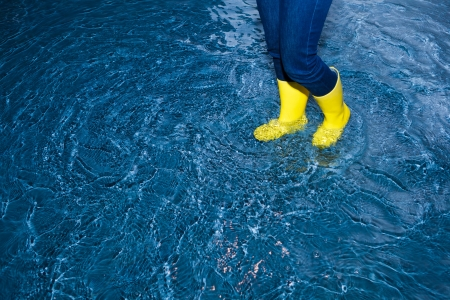rubber boots walking in the water photo