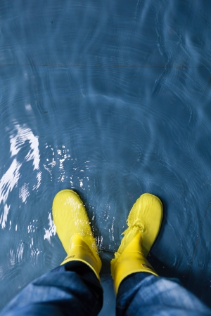 rubber boots in the water Stock Photo - 17375595