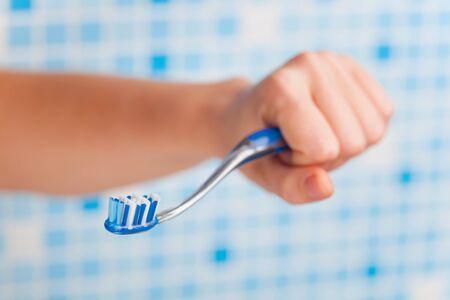 toothbrush in hand photo