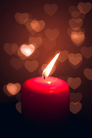 lit candle: fire of love Stock Photo