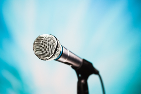 volume glow light: microphone against blue background
