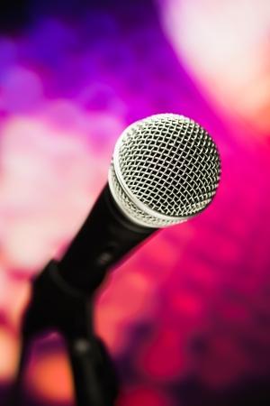 volume glow light: microphone against purple background