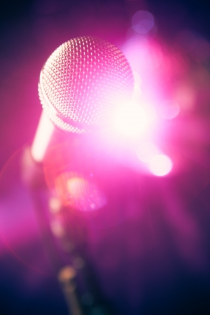volume glow light: microphone on stage with shiny glare