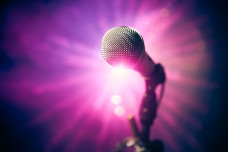 microphone on stage against purple rays Фото со стока - 18098798