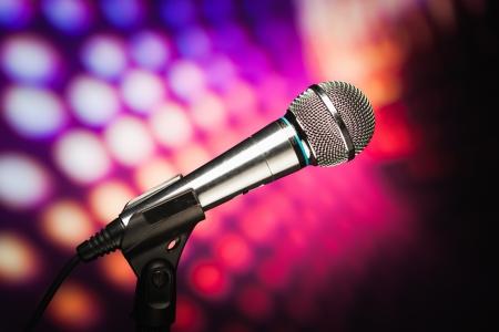 volume glow light: microphone against purple disco background