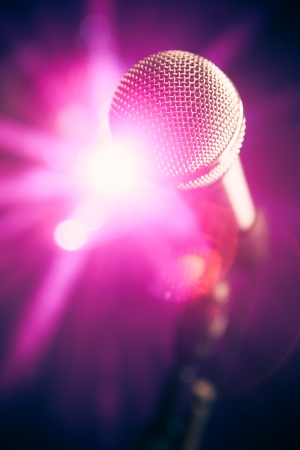 microphone on stage with purple shiny glare photo