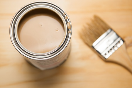 paint bucket: brown paint can and brush