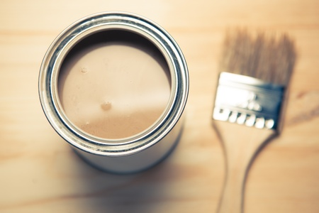 brown paint can and brush photo