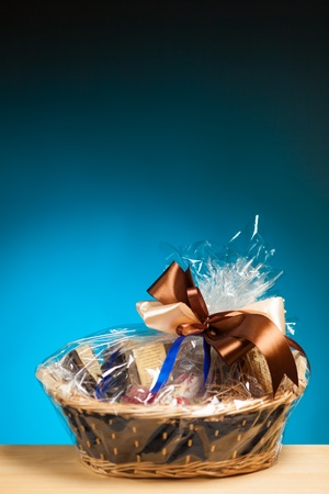 gift in a basket against blue background photo