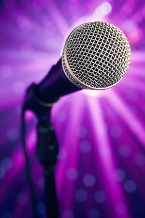 microphone against purple rays background photo