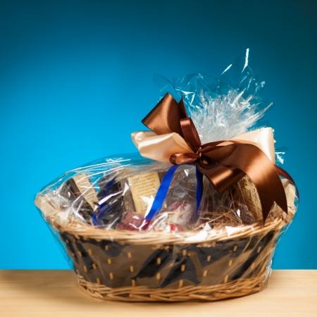 hamper: gift in a basket against blue background