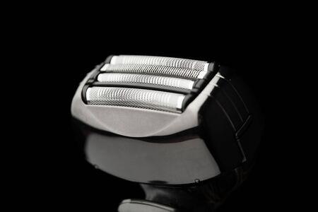 electric razor: electric razor isolated on black Stock Photo