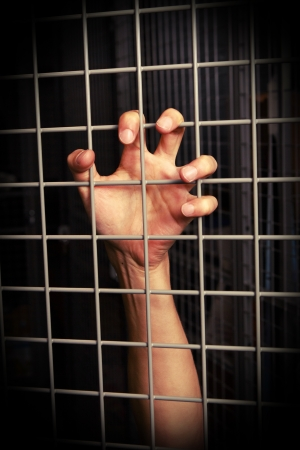 persecution: hand behind the lattice