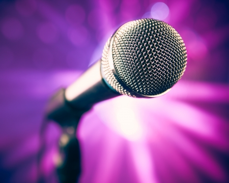 volume glow light: microphone on stage against purple rays
