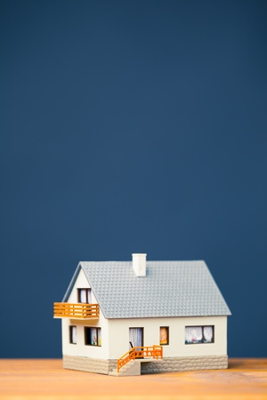 property development: classic house model on blue with copy-space Stock Photo
