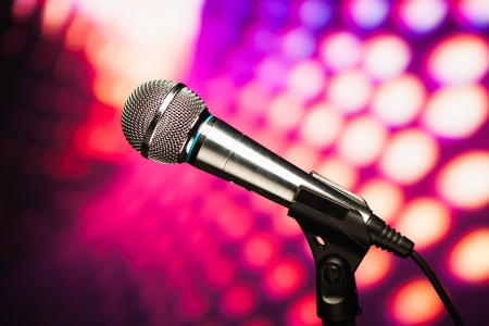 discoball: microphone against purple disco background