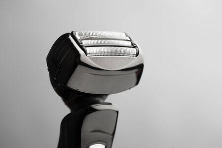 shaver: electric razor on grey background