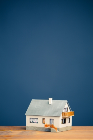 classic house model on blue with copy-space Stock Photo