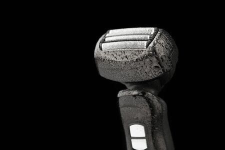 shaver: electric razor with wet drops, isolated on black