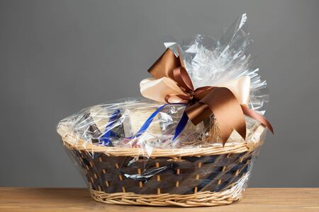 gift in a basket, grey background photo