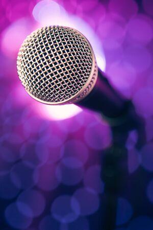 volume glow light: microphone against purple bokeh background
