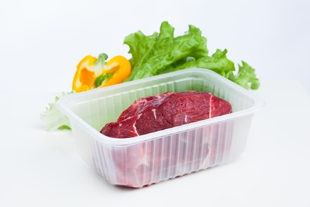 fresh raw meat and lettuce salad, white background Stock Photo - 20194955