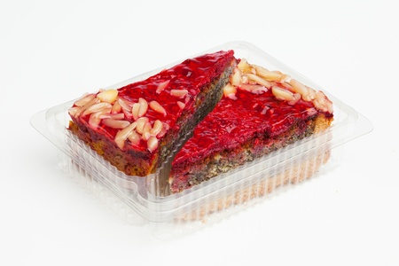 sweet cake in plastic tray photo