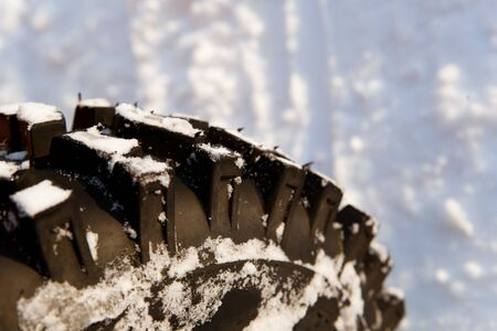 winter tire with snow Stock Photo - 21539669