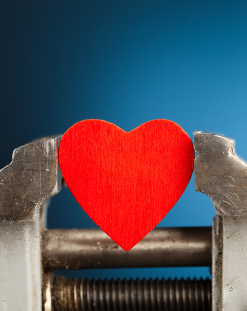 red heart in the vice tool Stock Photo - 22424325