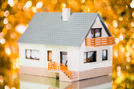 festive house against golden bokeh background photo