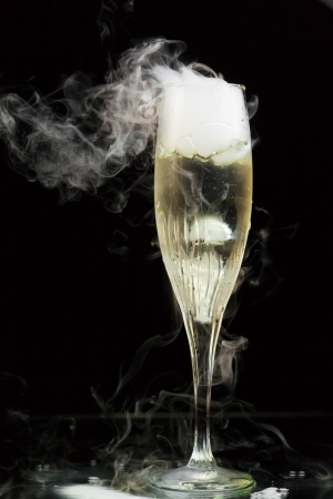 flute: champagne flute with ice vapor, black background Stock Photo