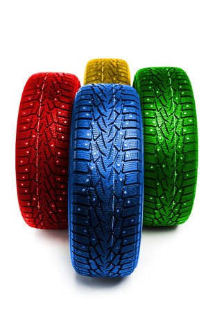 multicolor winter tires, isolated on white Stock Photo