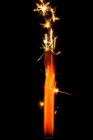 firework sparkler isolated on black photo
