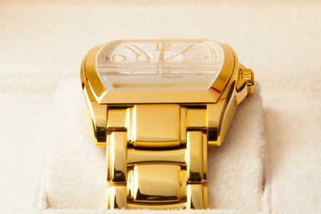 gold watch: golden watch on soft holder