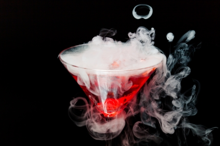 vapor: red cocktail with ice vapor Stock Photo