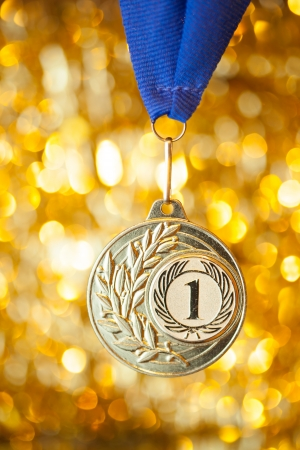 first place golden medal on shiny background photo