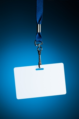name tags: empty white badge backdrop against blue background Stock Photo