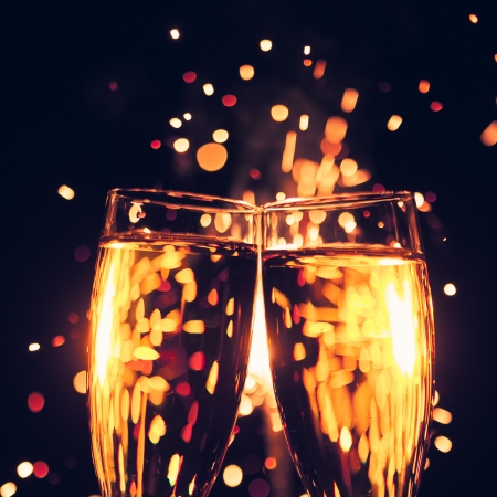 champagne glass against christmas sparkler background photo