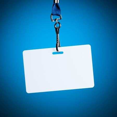 empty white badge backdrop against blue background Stock Photo
