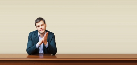 handsome business man on a desk photo